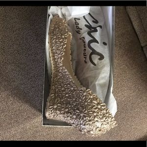 Glamorous gold wedge shoes.  Never worn.